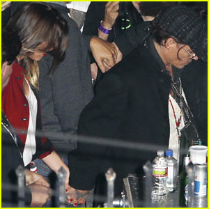 Johnny Depp & Amber Heard Hold Hands at Rolling Stones Concert