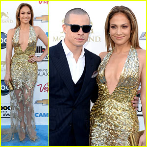 Jennifer Lopez bares it all in a gold sequinned gown
