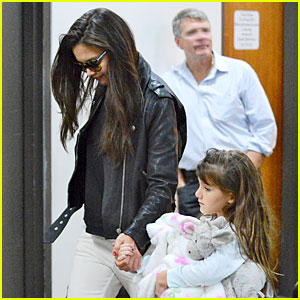 Katie Holmes & Suri Hold Hands After Rare LAX Landing!