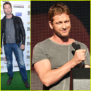 Gerard Butler Flashes Guns at Global Citizen Festival!