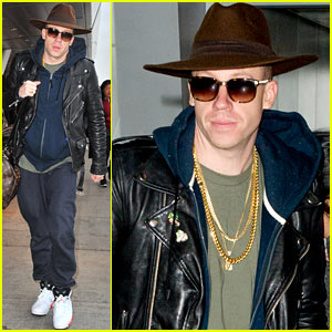 Macklemore Arrives at JFK Ahead of Winter Storm Hercules