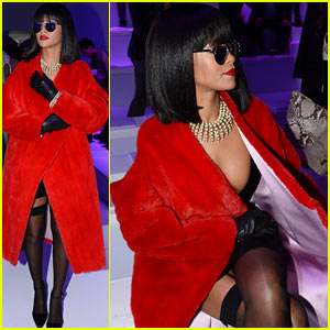 Rihanna Covers Up Her Sexy Black Dress with Red Coat at Dior Show