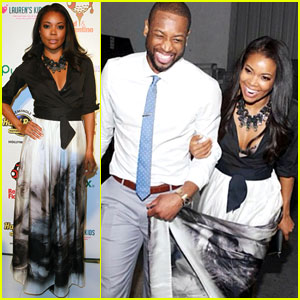 Dwyane Wade Helps Hold Up Fiance Gabrielle Union's Gown While Attending 'Call of the Game' Dinner