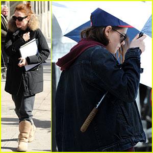 Kristen Stewart Shields Herself with an Umbrella on Set