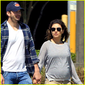 Pregnant Mila Kunis' Growing Baby Bump Is on Full Disp