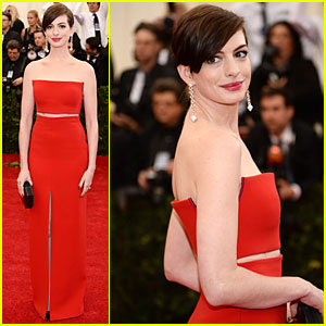 Anne Hathaway Flashes Midriff in Red Hot Dress at Met Ball 2014