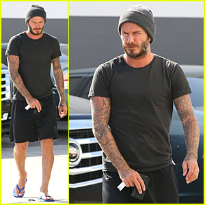 David Beckham Looks to Be Hiding Something With His Smartphone!