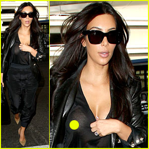 Kim Kardashian Exposes Herself in Sheer Top at LAX Airport