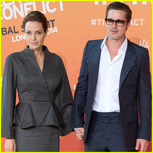 Angelina Jolie & Brad Pitt Arrive Hand-in-Hand for Anti-Rape Summit