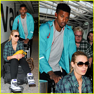 Iggy Azalea's Boyfriend Nick Young Pushes Her on a Luggage Cart