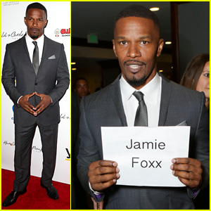 Jamie Foxx Carries a Sign with His Name On it, Just in Case