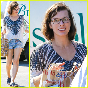 Milla Jovovich Keeps Her Tiny Baby Bump Covered Under Baggy Shirt