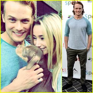 Outlander s sam heughan cuddles up to a puppy at saving spot amy