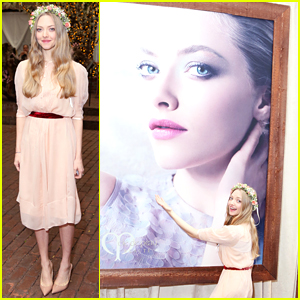 Amanda Seyfried Playfully Poses with a Giant Photo of Herself