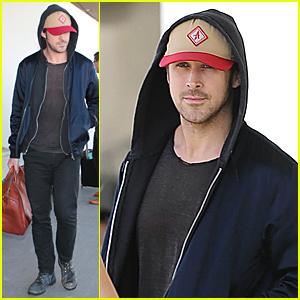 Ryan Gosling Hides New Brown Hair Under Cap at LAX Airport