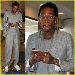 Wiz Khalifa Rides Hoverboard at LAX One Week After Arrest