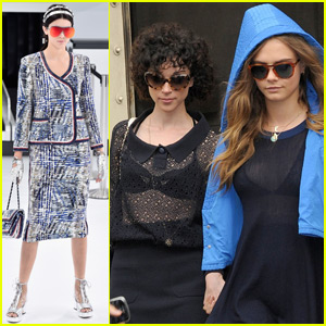 Cara Delevingne & St. Vincent Hold Hands While Watching Kendall Jenner Walk at Paris Fashion Week