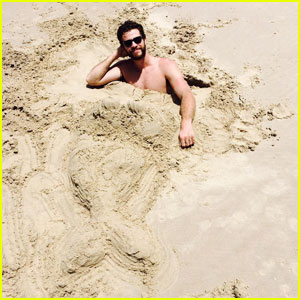 Liam Hemsworth is the Ultimate 'Merman' in the Sand