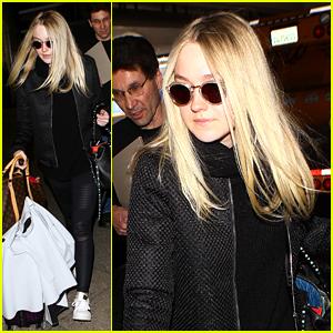 Dakota Fanning Returns to Los Angeles After Paris Fashion Week