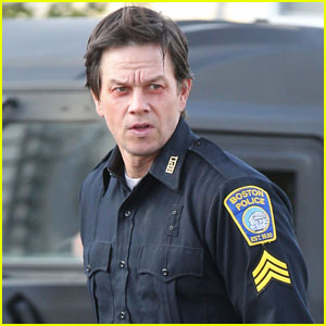 Mark Wahlberg looks pretty beat up in his cop uniform while shooting ...