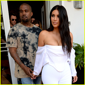 Kim Kardashian Flaunts Curves & Cleavage in White Jumpsuit