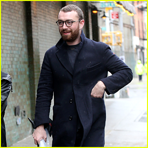 Sam Smith Braves Rain for City Stroll With Friends