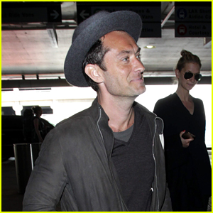 Jude Law sports a stylish hat as he heads through a terminal on his ...
