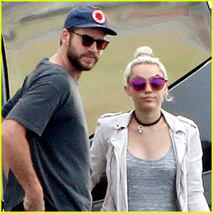 Miley Cyrus & Liam Hemsworth Fly Into Brisbane