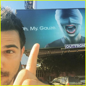 Taylor Lautner Poses With a Huge 'Scream Queens' Billboard