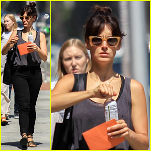 Lizzy Caplan Stops for a Cold Drink While Out & About in Beverly Hills
