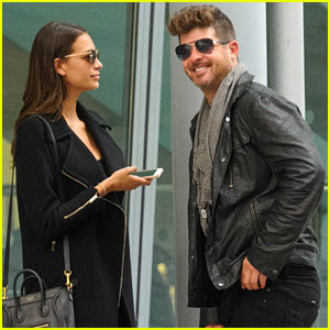 Robin Thicke & April Love Geary Head to London, Pack on the PDA