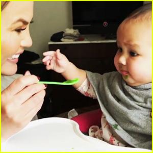 Watch Chrissy Teigen Feed Luna Her First 'Savory Bite' (Video)