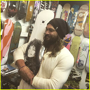 Jason Momoa Cuddles with Skateboard That Has Wife Lisa Bonet's Face on It