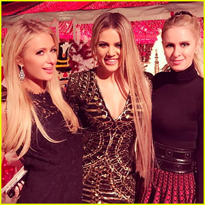 Paris Hilton Snaps Tons of Pics at Kardashian Christmas Party 2016