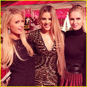 Paris Hilton Snaps Tons of Pics at Kardashian Christmas Party 2016