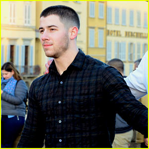 Nick Jonas Defines Dapper While Drinking Champagne on a Boat in His Turtleneck