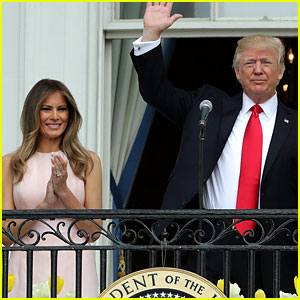 Melania Trump Nudges President Trump to Raise Hand During National Anthem