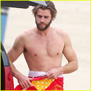 Liam Hemsworth Goes Shirtless While Surfing in Malibu