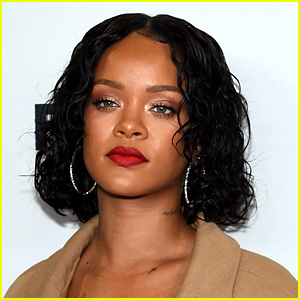 Rihanna Caught Making Out with Mystery Man in Spain!