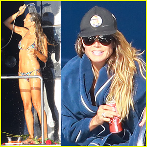 Heidi Klum Rinses Off in Tiny Bikini With Roses at Her Feet