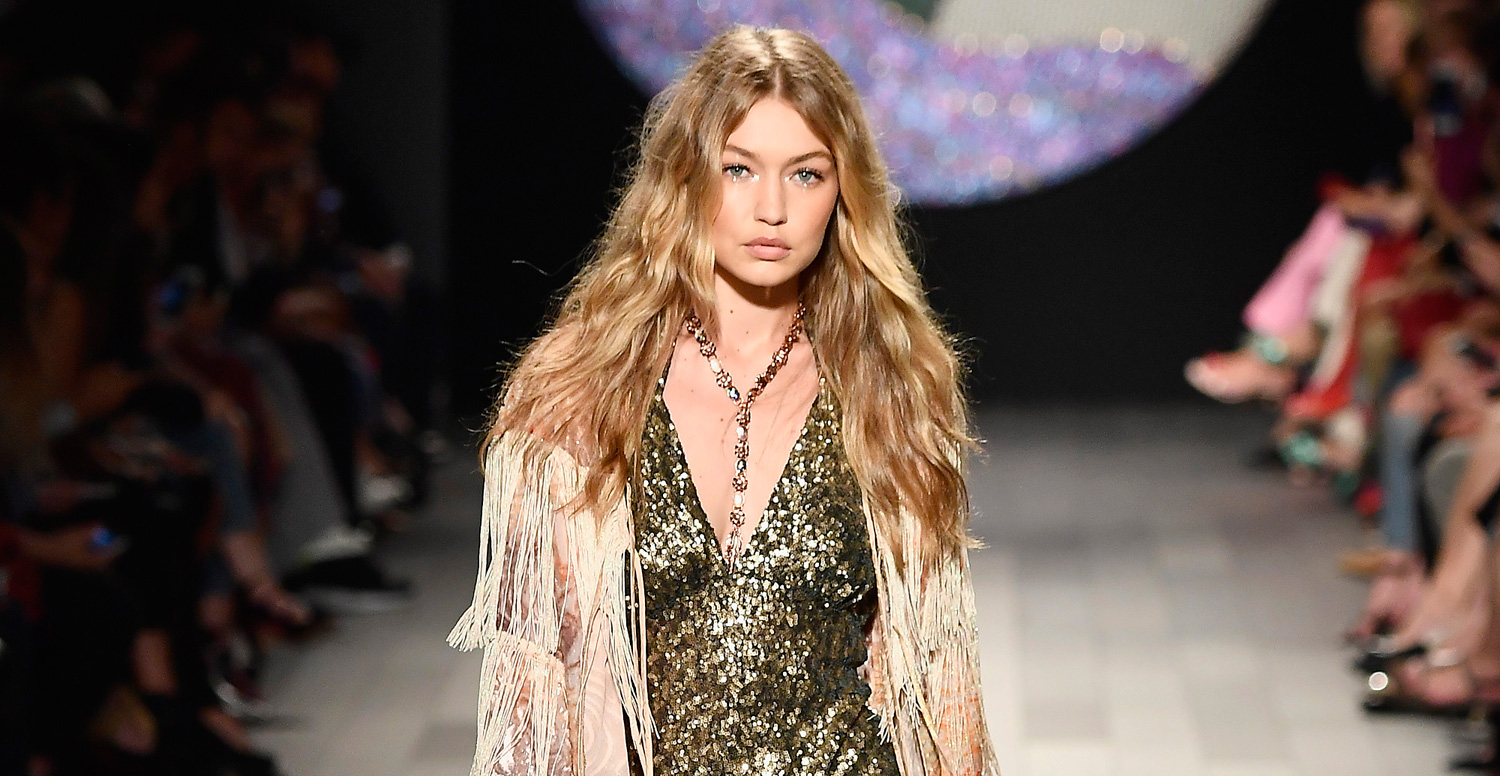Gigi Hadid Loses High Heel Mid-Runway During Anna Sui Show