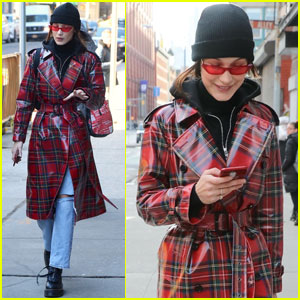 Bella Hadid Is All Smiles While Checking Her Phone!