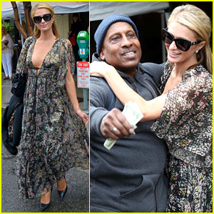 Paris Hilton Gives Man on the Street a Wad of 20-Dollar Bills!