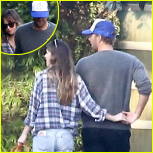 Dakota Johnson & Chris Martin Show Some Sweet PDA on Their Sunday Stroll