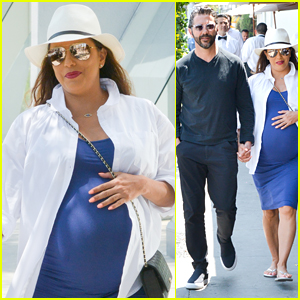 Eva Longoria Cradles Baby Bump While Out with Jose Baston!