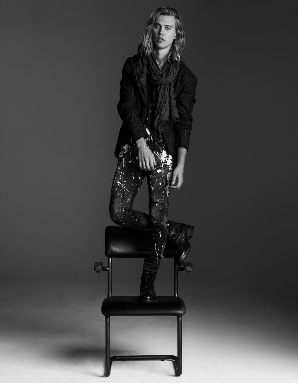 Austin Butler standing on top of a chair