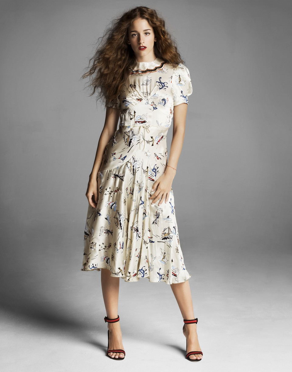 Coco Konig poses for a full length portrait in a Tommy Hilfiger dress